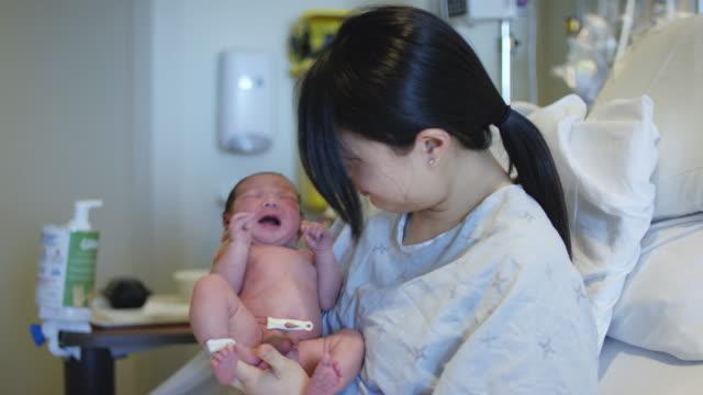 Holding Upset Newborn