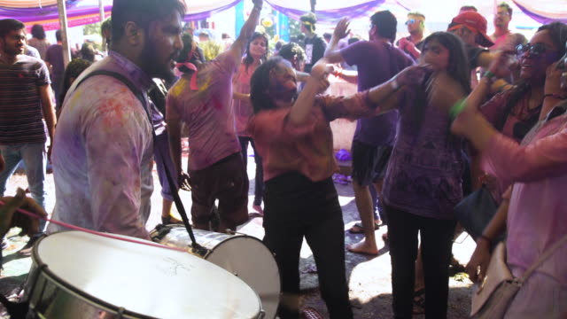holi festival party at india, chennai. percussion band playing - bollywood stock videos and b-roll footage