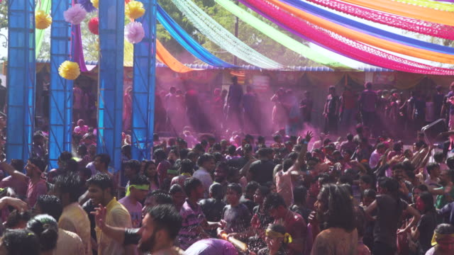 holi festival party at india, chennai. young people dancing inside a pool - tradition stock-videos und b-roll-filmmaterial