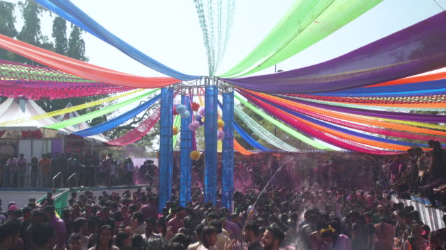 holi festival party at india, chennai. young people dancing inside a pool - chennai stock videos & royalty-free footage