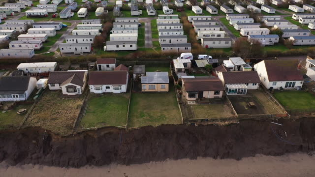 holiday caravans and homes sit on the eroded clifftop in the village of skipsea on the yorkshire coast on january 27, 2020 in bridlington, united... - coastal feature stock videos & royalty-free footage