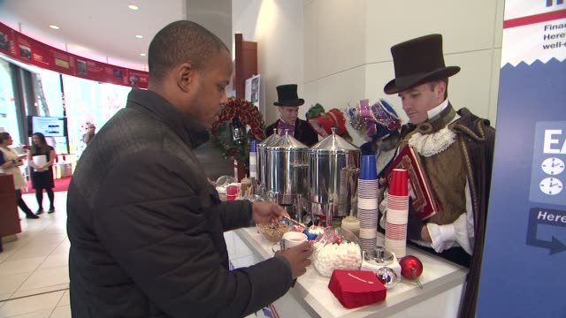 holiday coffee served at jane krakowski and bank of america help new yorkers spread holiday cheer on december 12 2012 in new york new york - bank of america stock videos & royalty-free footage