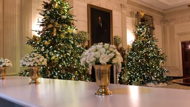 Holiday decorations celebrating the 'country's national symbols including the bald eagle the rose and the oak tree' are on display in the State...