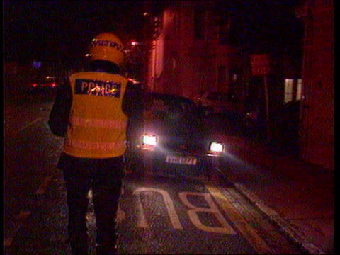 holiday drink driving itn lib england sussex bv policeman orders car to pull to side of road cms policeman administering breath test to man tcs... - alkoholtest stock-videos und b-roll-filmmaterial