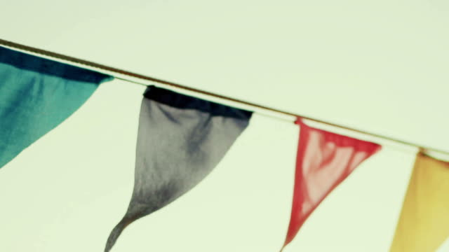 holiday, festive flags on the beach - folk music stock videos and b-roll footage