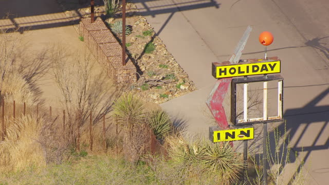 MS AERIAL TS Holiday Inn sign / Marfa, Texas, United States