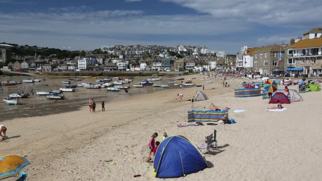holiday makers in st ives, cornwall, uk. - coastline stock videos & royalty-free footage