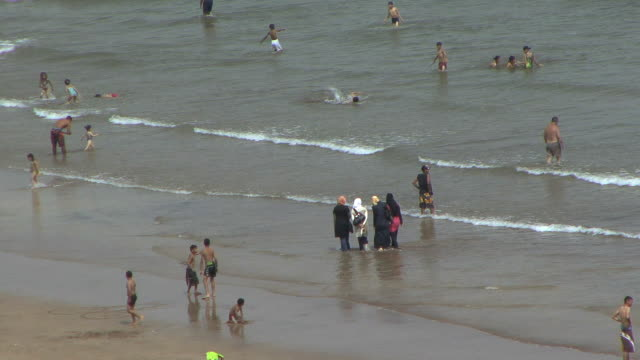 ws ha holiday makers on beach, rabat, morocco - hijab stock videos and b-roll footage