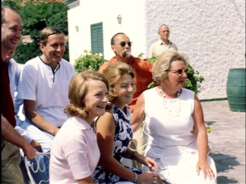 holiday of the royal family in italy, the press makes film recordings and takes pictures / porto ercole, italy - oberschicht stock-videos und b-roll-filmmaterial