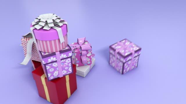vidéos et rushes de cadeaux pour les fêtes de fin d'année - fond coloré