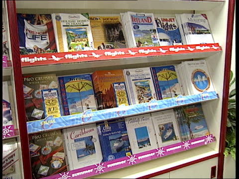 london gv lots of holiday brochures on shelf in travel agents pan lr cms princess cruises brochure cms airtours brochure cms princess cruises and... - brochure stock videos & royalty-free footage