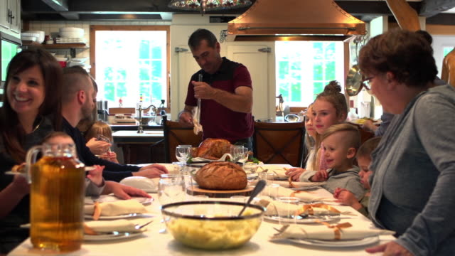 holiday season family group diner - large family stock videos & royalty-free footage