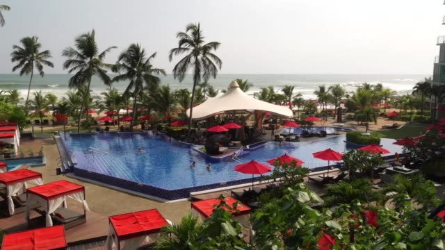 holidaymakers at a resort in galle beach sri lanka - outdoor chair stock videos & royalty-free footage