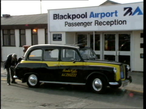 holidaymakers flying from the uk and holidaying in majorca england lancashire blackpool blackpool airport entrance to blackpool airport passenger... - sombrero stock videos & royalty-free footage