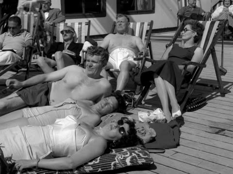 holidaymakers relax and sunbathe onboard a cruise liner - sunbathing stock videos & royalty-free footage