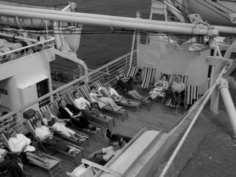 holidaymakers relax on deckchairs onboard a cruise liner - outdoor chair stock videos & royalty-free footage