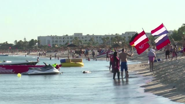 holidaymakers spend time at the beach in the northeastern town of nabeul as tourists return to the tunisian seaside this summer in a marked... - tunisia stock videos & royalty-free footage