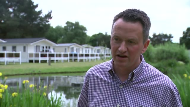 holidaymakers taken to hospital after chlorine leak at resort swimming pool ian pennell interview sot car along leaving holiday park reporter to... - 退院点の映像素材/bロール