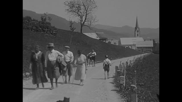 holidays of a family in the kleinwalsertal in 1932 visiting hirschegg mittelberg and ritzlern views to the mountains alps typical alpine farmers... - alpi video stock e b–roll