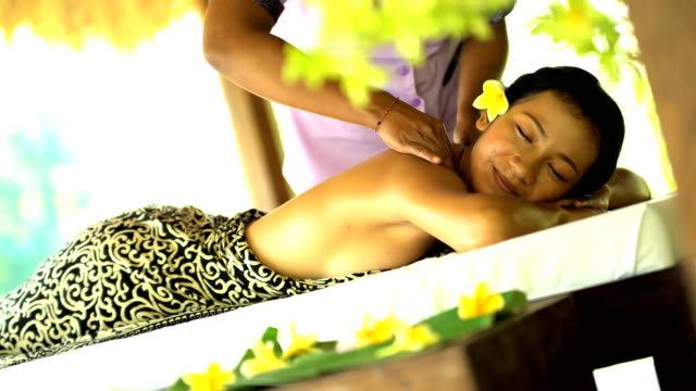 holistic therapy by masseuse in luxury hotel indonesia - wellbeing stock videos & royalty-free footage