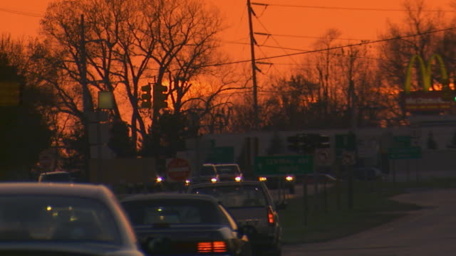 holland, michiganbusy street at sunset - michigan stock videos and b-roll footage