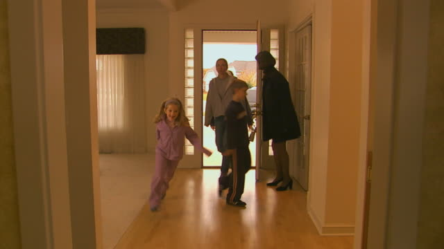 Holland, MichiganFamily enters home through front door