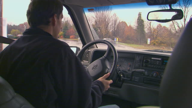 holland, michiganman driving suburban - driver's seat stock videos and b-roll footage