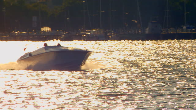 holland, michiganpower boat on lake macatawa - power boat stock videos & royalty-free footage