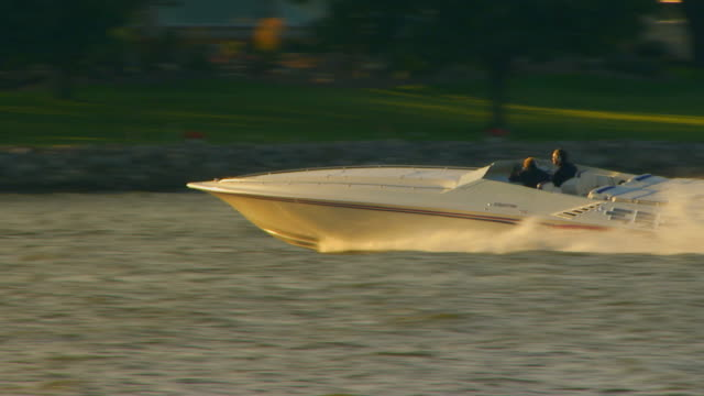 holland, michiganpower boat ripping it up on lake macatawa - power boat stock videos & royalty-free footage