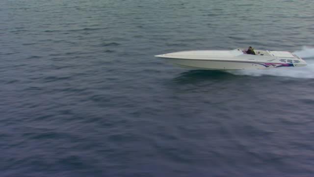 holland, miflying alongside a power boat, then boat turns - モーターボート点の映像素材/bロール