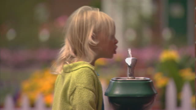 Holland, MIGirl drinking from fountain