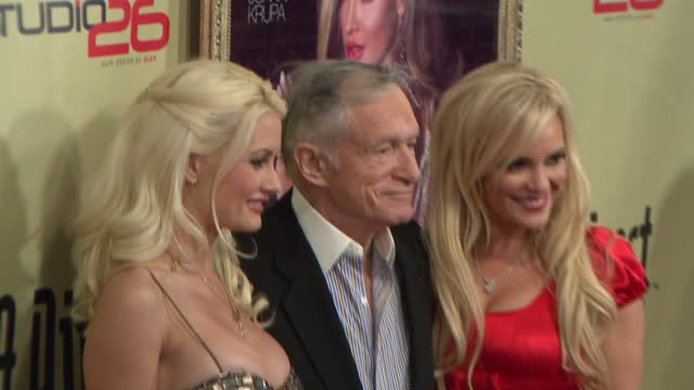 Holly Madison Hugh Hefner and Bridget Marquardt at the LA Direct Magazine's Holiday Party at Les Deux in Los Angeles California on December 14 2007