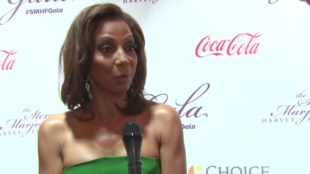 holly robinson peete on the harvey family, quotes marian wright edelman on service being the rent we pay for living at the 2015 steve & marjorie... - tamron hall stock videos & royalty-free footage