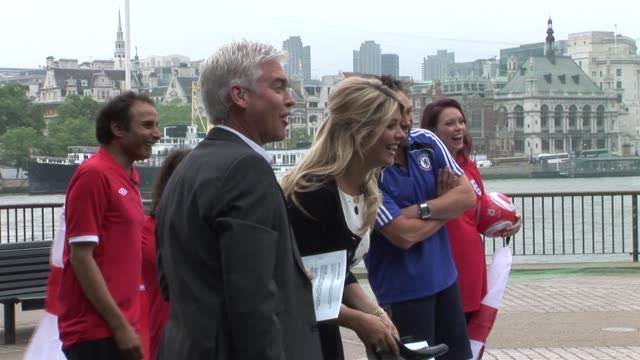 holly willoughby phillip schofield take penalties on the bank of the river thames to celebrate the start of the world cup at the celebrity sightings... - phillip schofield stock videos & royalty-free footage