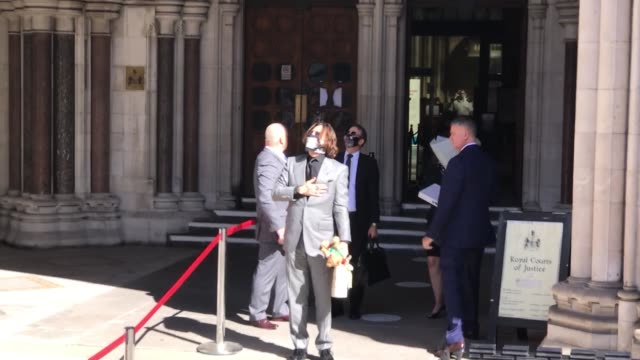 hollywood actor johnny depp arrives at the royal courts of justice in london on july 28 2020 for the final day of hearing over the sun's claim that... - johnny depp stock videos & royalty-free footage