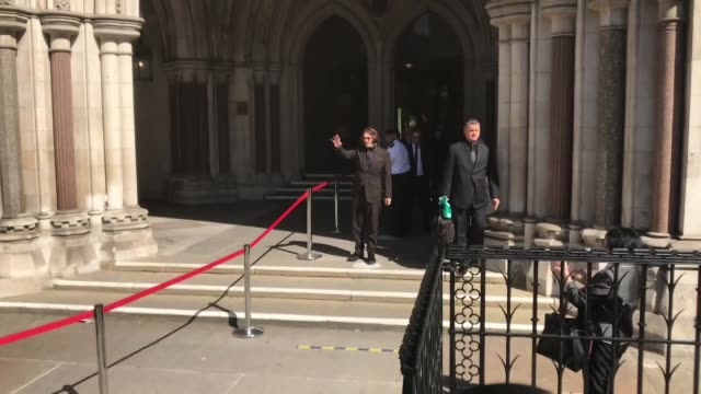 hollywood actor johnny depp has arrived at the high court on wednesday, july 22, for hearing over the sun's claim that the star abused his ex-wife... - sky stock videos & royalty-free footage