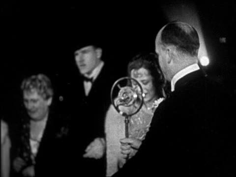 "hollywood actress in gown talking into microphone at ""interference"" premiere / newsreel - 1928 stock videos & royalty-free footage"