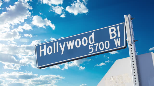hollywood blvd road sign - 4k timelapse - hollywood boulevard stock videos & royalty-free footage