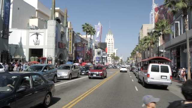 hollywood boulevard, hollywood and view of tcl chinese theatre, los angeles, california, united states of america, north america - mann theaters stock videos & royalty-free footage