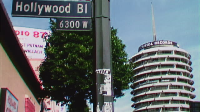 hollywood boulevard sign, capitol records building in background - capital letter stock videos & royalty-free footage