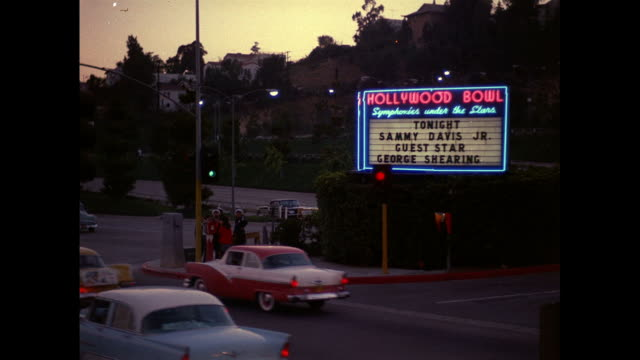hollywood bowl sign advertising house of sight and sound concert with sammy davis jr and guest star, george shearing / traffic on three-lane highway... - george shearing stock-videos und b-roll-filmmaterial