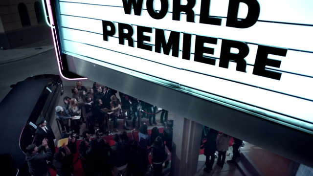 hollywood couple leaving world premiere walk down red carpet to limousine at awards show - academy of motion picture arts and sciences stock videos and b-roll footage