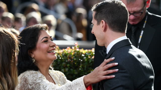 Hollywood Foreign Press Association President Meher Tatna and Host Andy Samberg embrace on the red carpet during the 76th Annual Golden Globe Awards...