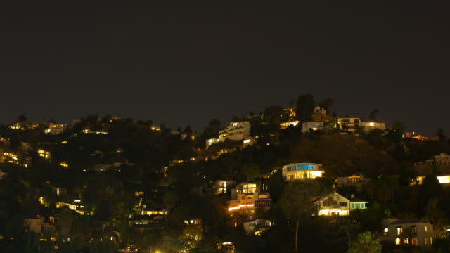 stockvideo's en b-roll-footage met hollywood hills timelapse night to day - hollywood california