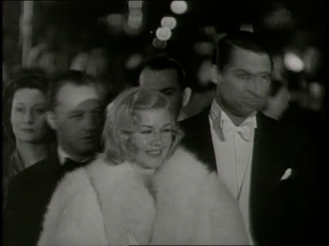 vídeos de stock, filmes e b-roll de / hollywood movie stars including cary grant ginger rogers and marlene dietrich arrive at an award show and step out of a car / james whitmore's... - estreia
