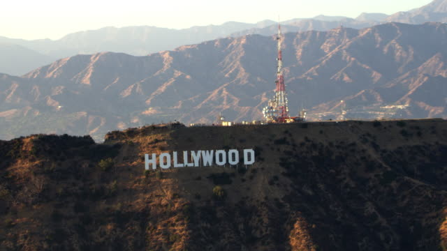 AERIAL Hollywood sign on top of Mount Lee in LA in sunshine