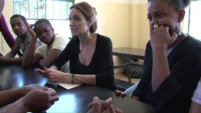 stockvideo's en b-roll-footage met hollywood star angelina jolie makes a surprise visit to a detention centre in malta meeting asylum seekers who have fled unrest in libya in recent... - valletta