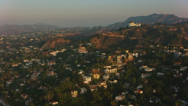 aerial hollywood with griffith observatory on the slope of mt. hollywood in the morning - griffith observatory stock videos & royalty-free footage