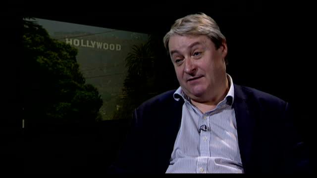 hollywood writers threaten to strike; england: london: int bernie corbett interview sot - author stock videos & royalty-free footage