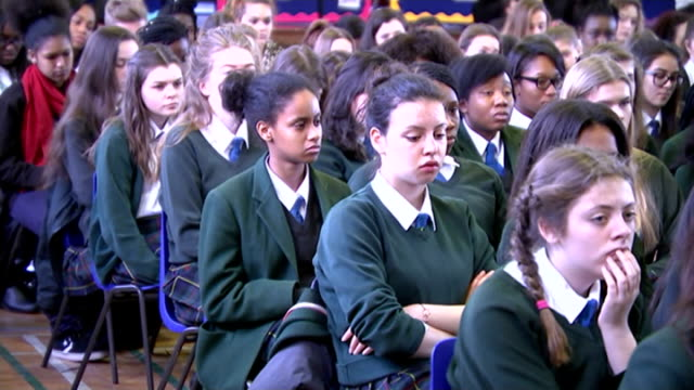 uk ceremonies and events london camdenla sainte union int gena turgel walking along helped by man into school hall school children sat in school hall... - ausgemergelt stock-videos und b-roll-filmmaterial